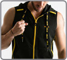 Sleeveless semi-fitted zipped jacket with non removable hood. Made of quick dry...