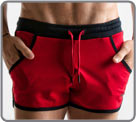 Mini short waist in fast-drying sport fabric. Color contrast and iconic logo...