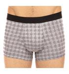 Un motif à carreaux tissés intemporel pour des dessous masculins, élégants.