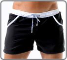 Low-cut swim shorts made of high-end fabric. Contrasting colors on the and on a...