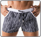 Low-cut bath shorts made from high-end fabric. Snakeskin type print. White Side...