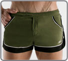 Low-waisted short swim shorts made of high-end fabric. The sides have buttons a...