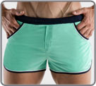 Low-cut short bath shorts, made of high-end fabric. Contrasting borders, small...
